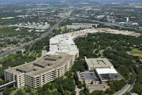The main USAA headquarters building is seen in an Aug. 24, 2013 aerial image looking south. The company plans to add 1,500 new jobs in San Antonio.
