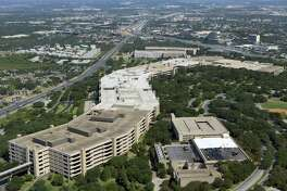 USAA has agreed to pay up to $39 million to settle a class-action lawsuit initiated by some of its members in Florida. Shown is the company's San Antonio campus in 2013.