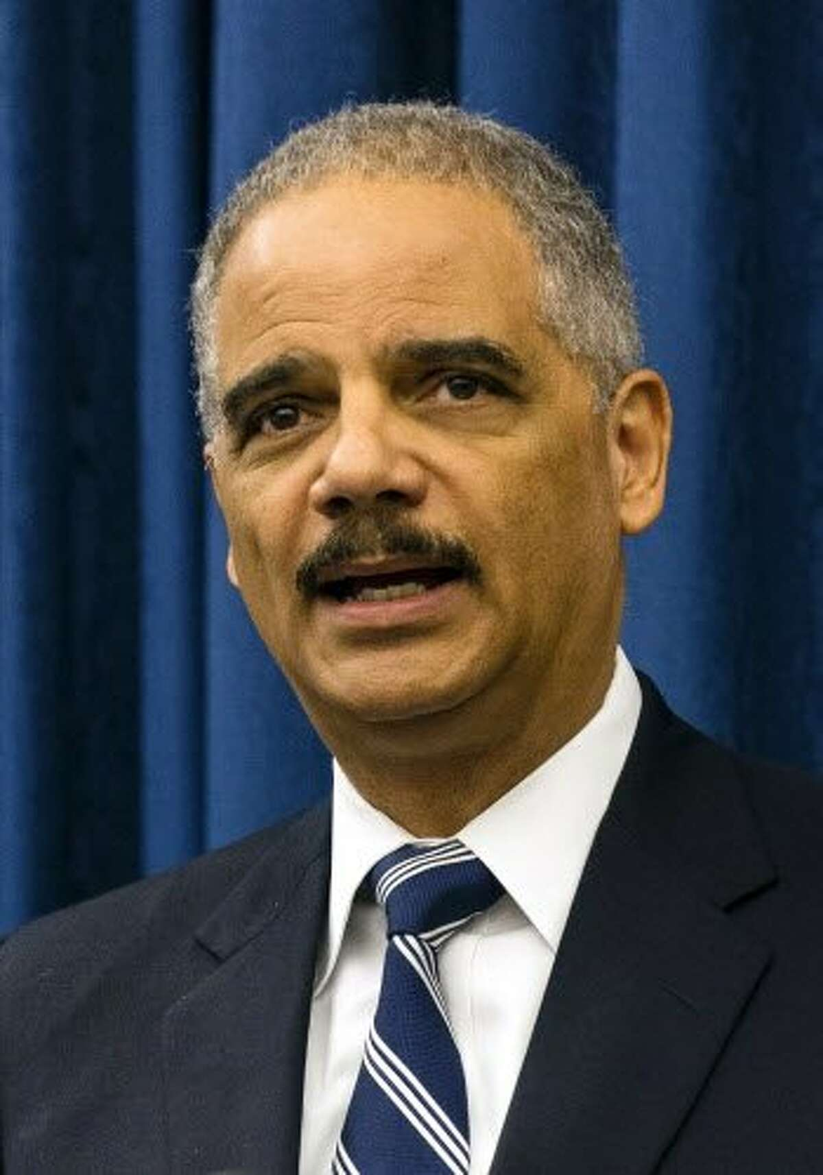 FILE-- U.S. Attorney General Eric Holder.Holder has come out against proposals in Chicago and New Jersey to require fingerprint background checks of drivers for Uber and Lyft.