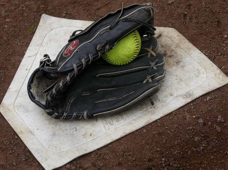 Eva Silverman prepares for the upcoming softball season with her 15-year-old Rawlings softball glove at San Pablo Park in Berkeley, Calif., on Thursday, Feb. 4, 2010. Photo: Paul Chinn, The Chronicle