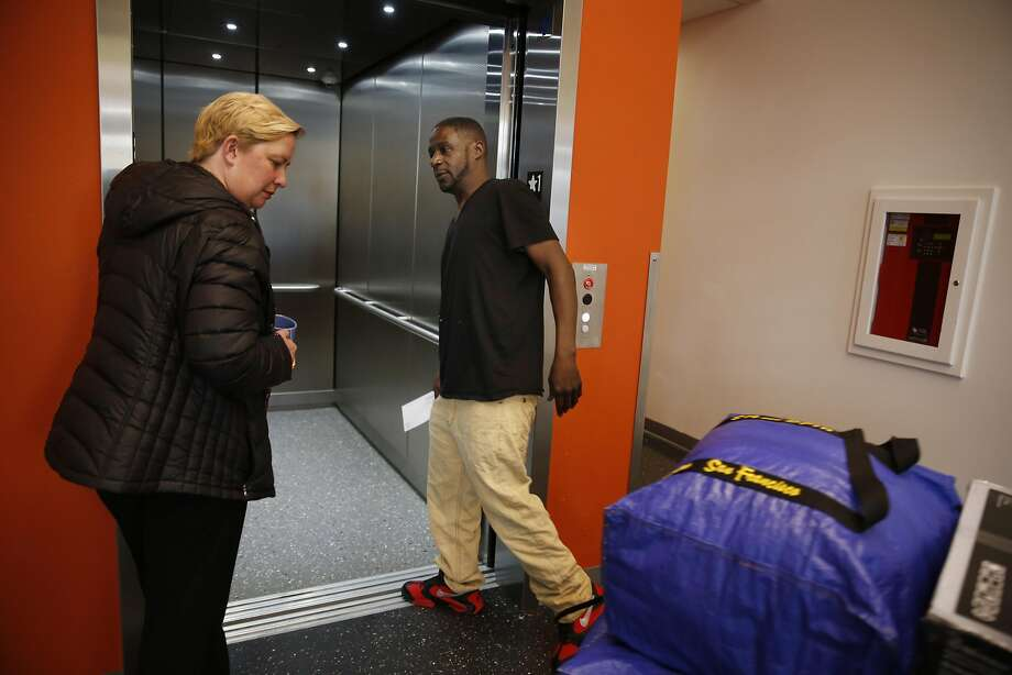 Vernon Mandigo (right), Franciscan Towers tenant who is formerly homeless, and Rose Chastain (left), event manager Tenderloin Neighborhood Development Corporation, enter the elevator from the lobby at the Franciscan Towers on Monday, April 4, 2016 in San Francisco, California. Photo: Lea Suzuki, The Chronicle