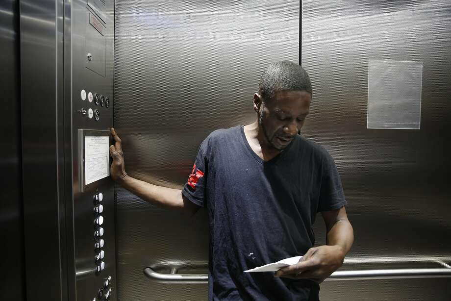 Vernon Mandigo, Franciscan Towers tenant who is formerly homeless, looks over mail in the elevator at the Franciscan Towers on Monday, April 4, 2016 in San Francisco, California. Photo: Lea Suzuki, The Chronicle