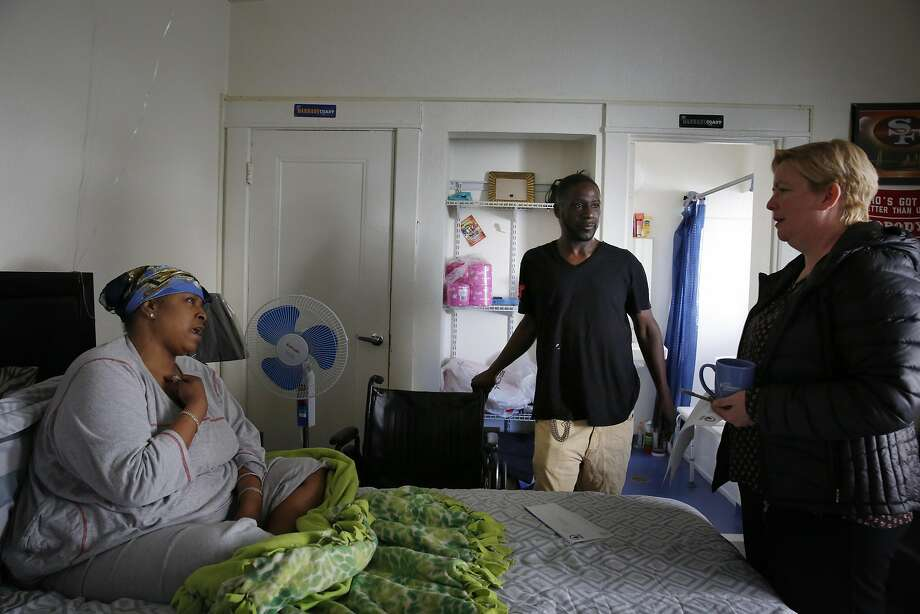 Vernon Mandigo (center) and Tashina Fort (right)  talk  with Rose Chastain (left), event manager Tenderloin Neighborhood Development Corporation,  as she visits with them  in their apartment at the Franciscan Towers on Monday, April 4, 2016 in San Francisco, California. Photo: Lea Suzuki, The Chronicle