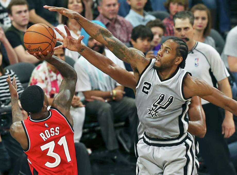 Kawhi Leonard gets over to block the shot of Terrence Ross as Tim Duncan also reaches on defense as the Spurs play Toronto at the AT&T Center on April 2, 2016. Photo: TOM REEL, STAFF / SAN ANTONIO EXPRESS-NEWS / 2016 SAN ANTONIO EXPRESS-NEWS