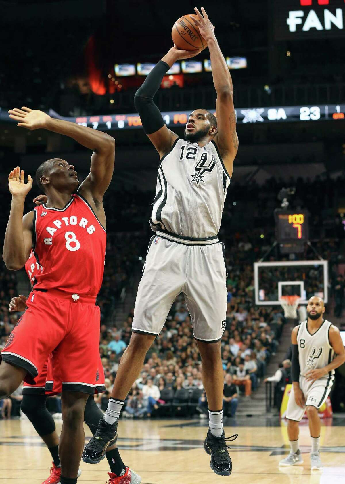 LaMarcus Aldridge pumps another shot over Bismack Biyombo as the Spurs play Toronto at the AT&T Center on April 2, 2016.