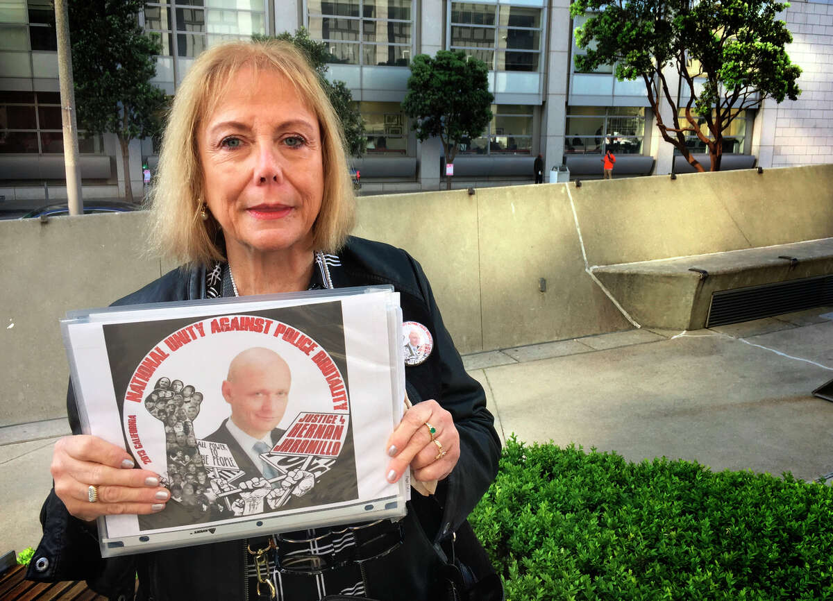 Ana Biocini holds a picture of her brother, Hernan Jaramillo, who died while being handcuffed by Oakland police in 2013. Biocini agreed to a settlement in a wrongful-death lawsuit against the city of Oakland but changed her mind and wants to mover forward with a trial.