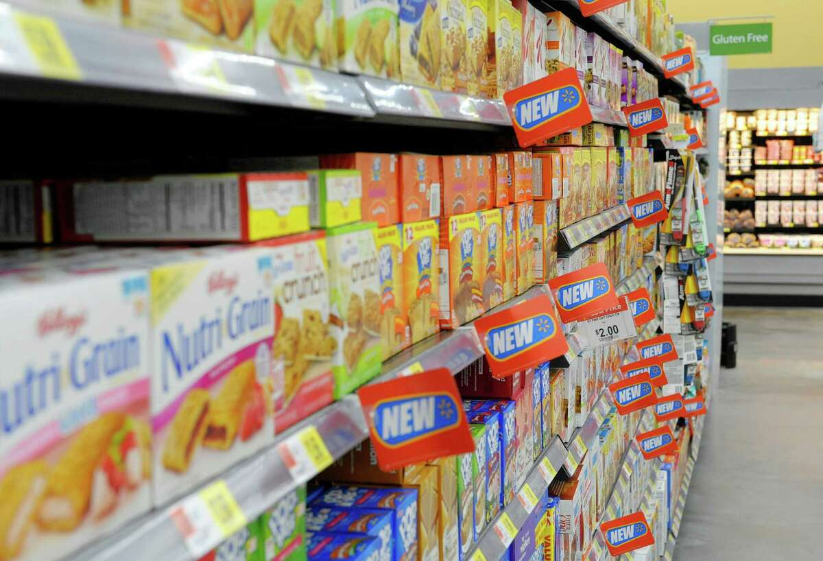 Tags mark items that are new products from manufacturers on the shelves at the Walmart Neighborhood Market on Thursday, Oct. 31, 2013 in Niskayuna, NY. (Paul Buckowski / Times Union)