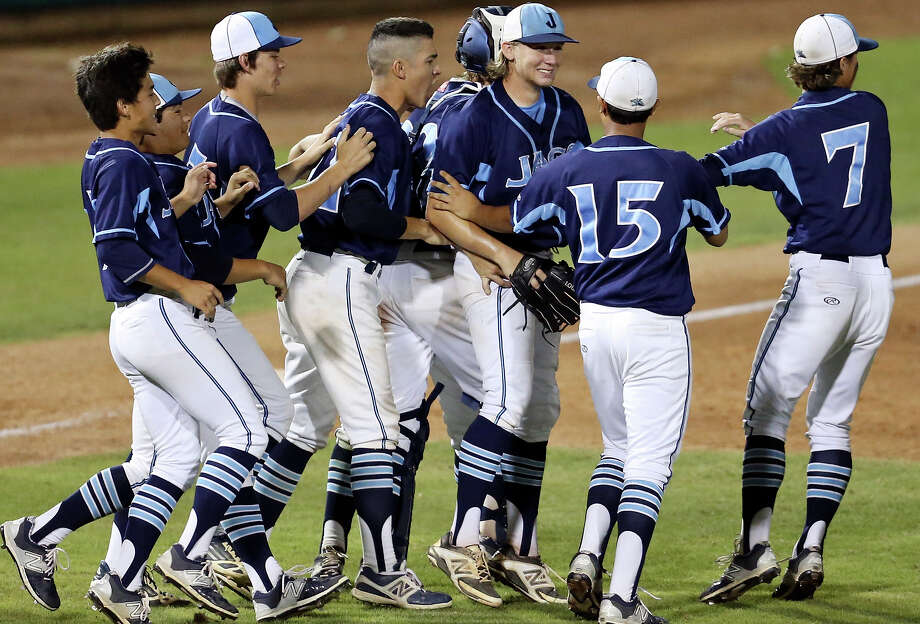 Members of the Johnson Jaguars baseball team celebrate their 1-0 win over Edinburg after Game 1 of their Class 6A regional semifinal series on May 29, 2015 at Wolff Stadium. Photo: Edward A. Ornelas /San Antonio Express-News / © 2015 San Antonio Express-News