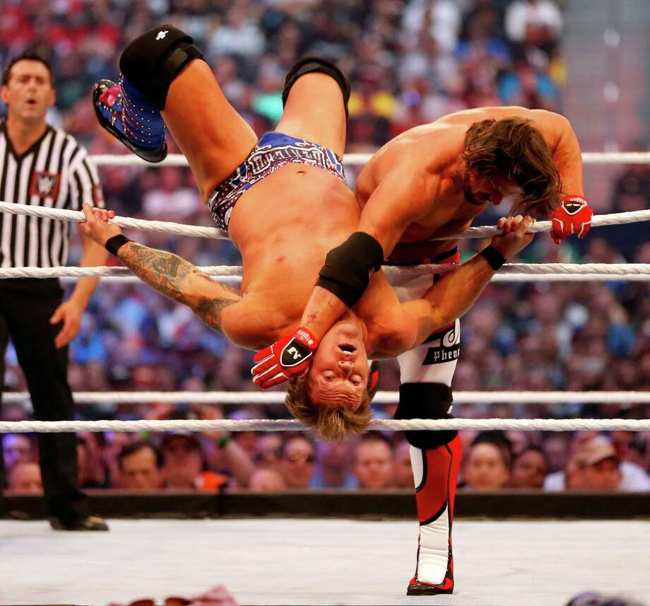 AJ Styles,right, wrestles with Chris Jericho during WrestleMania 32 at AT&T Stadium in Arlington, Texas, Sunday, April 3, 2016.  (Jae S. Lee/The Dallas Morning News via AP) Photo: Jae S. Lee, MBR / The Dallas Morning News