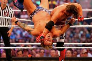 AJ Styles,right, wrestles with Chris Jericho during WrestleMania 32 at AT&T Stadium in Arlington, Texas, Sunday, April 3, 2016.  (Jae S. Lee/The Dallas Morning News via AP)