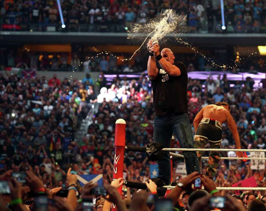"""""""Stone Cold"""" Steve Austin smashes two beers together at Wrestlemania 32 at AT&T Stadium in Arlington, Texas, Sunday, April 3, 2016.Keep clicking to take a look at the highest paid wrestlers in WWE. Photo: Richard W. Rodriguez, MBI / Star-Telegram"""