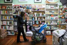 New mom Rose Collins, 36, shops for a new outfit with son Jack Collins, 4 months, at Natural Resources maternity store in San Francisco, California on Tuesday, January 12, 2016.