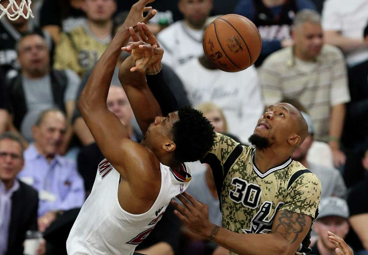 purs' David West defends against Miami Heat's Hassan Whiteside during the second half at the AT&T Center on March 23, 2016.
