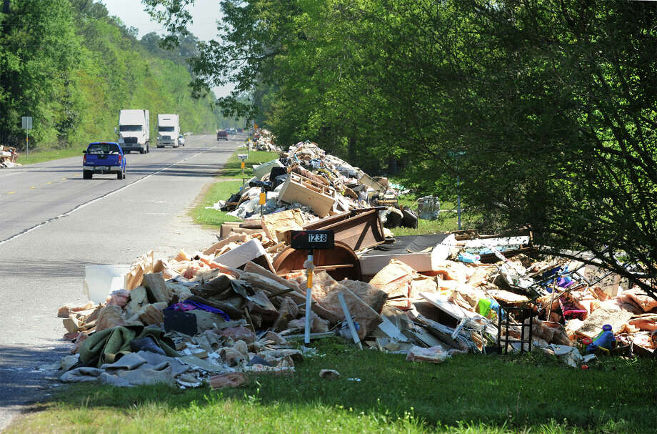 Flood damaged materials and debris line Texas 87 in Deweyville where the Texas Department of Transportation said they will pick it up the week of  April 11.   Photo taken Monday, April 4, 2016 Guiseppe Barranco/The Enterprise Photo: Guiseppe Barranco, Photo Editor