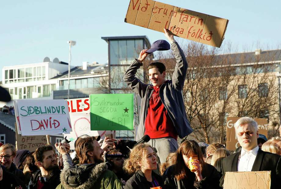 """An estimated 8,000 protesters met in Reykjavik on Monday to demand the resignation of Iceland's prime minister Sigmundur David Gunnlaugsson over details in the """"Panama Papers."""" Photo: Brynjar Gunnasrson, STR / AP"""