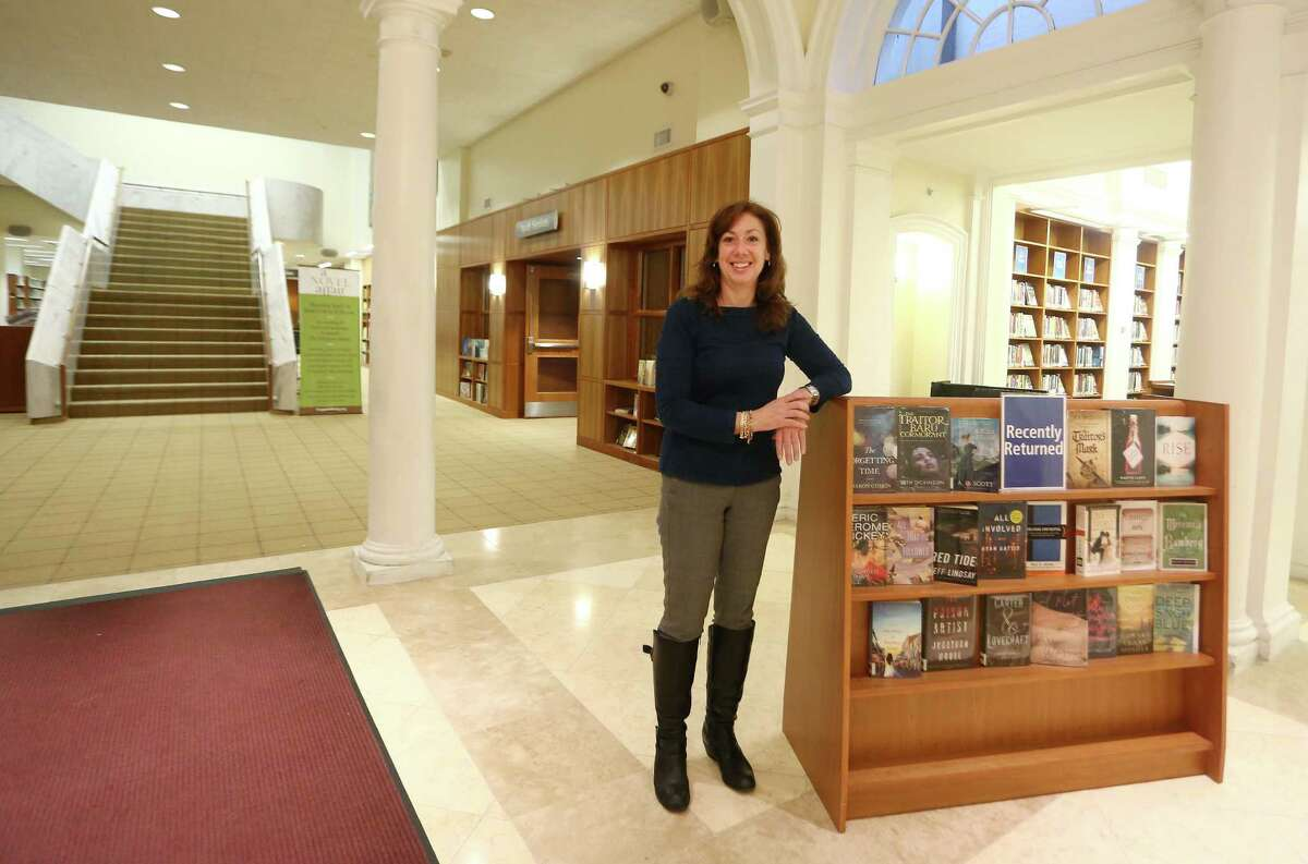 Jeanne Peloso poses for a photo inside the lobby of downtown Stamford's Ferguson Library on Monday April 4, 2016. Peloso, a volunteer at Ferguson Library, is helping plan an upcoming April 14 fundraiser A Novel Affair, an event which will include food from local Stamford eateries as well as music and fun.