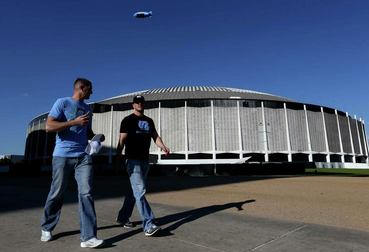 North Carolina fans walk past the Astrodome before the start of the men's NCAA Division I national championship game between Villanova and North Carolina at NRG Stadium Monday, April 4, 2016, in Houston. The Astrodome was the site of the finals between No. 2 Houston and No. 1 UCLA in January 1968.