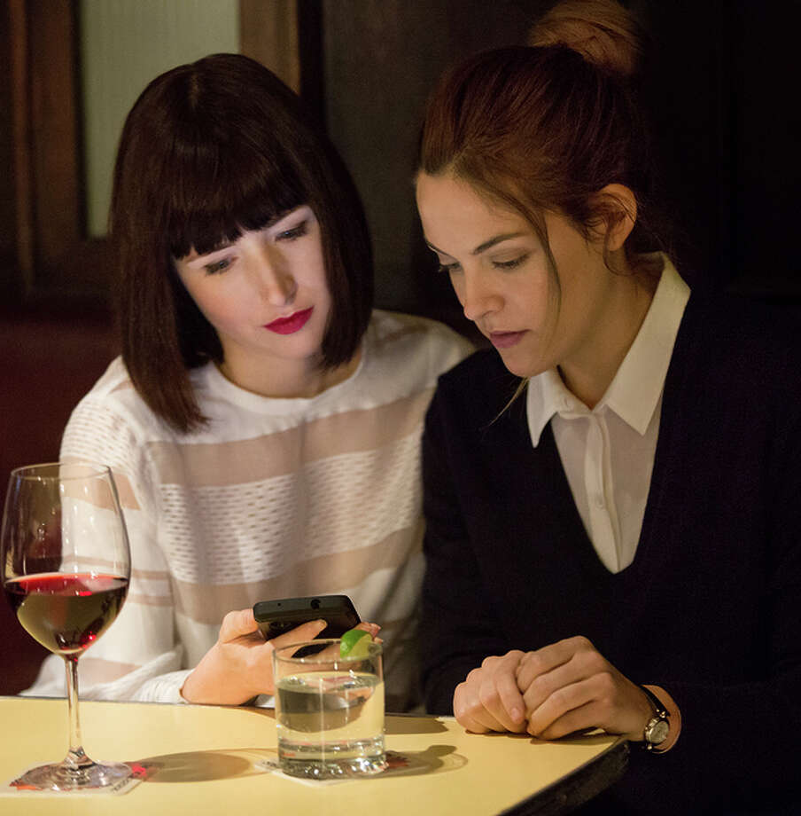 Avery Suhr (Kate Lyn Sheil, left); the cynically narcissistic Christine (Riley Keough). Photo: KERRY HAYES / Kerry Hayes / Starz Entertainment / © 2016 Transactional Pictures of NY LP. All Rights Reserved.
