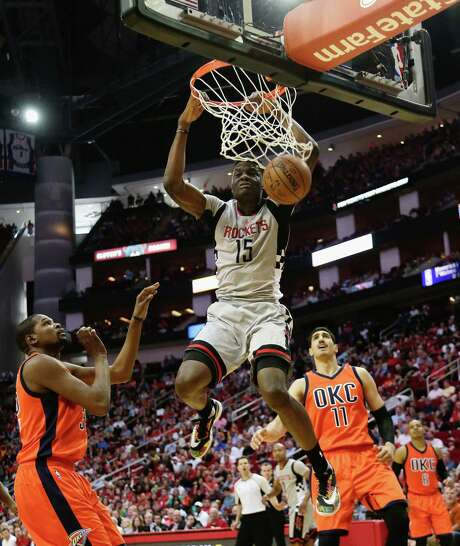 Clint Capela scores two of his nine points against the Thunder and Enes Kanter on Sunday. Interim coach J.B. Bickerstaff praised Capela's contributions. Photo: Bob Levey, FRE / FR156786 AP