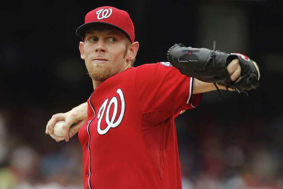 WASHINGTON, DC - AUGUST 03:  Starter Stephen Strasburg #37 of the Washington Nationals pitches against the Philadelphia Phillies in the first inning at Nationals Park on August 3, 2014 in Washington, DC.  (Photo by Jonathan Ernst/Getty Images) ORG XMIT: 477587385 Photo: Jonathan Ernst / 2014 Getty Images