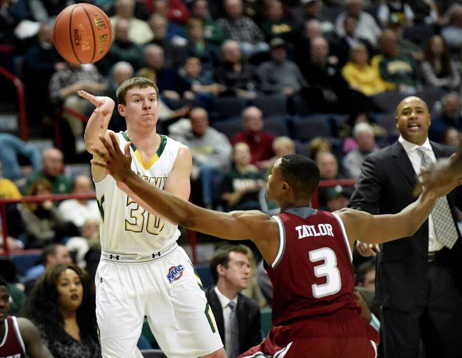 Siena's Kinnon LaRose, left, passes the ball as Rider's Jimmie Taylor defends during their basketball game on Thursday, Jan. 21, 2016, at Times Union Center in Albany, N.Y. (Cindy Schultz / Times Union) Photo: Cindy Schultz / 10034934A