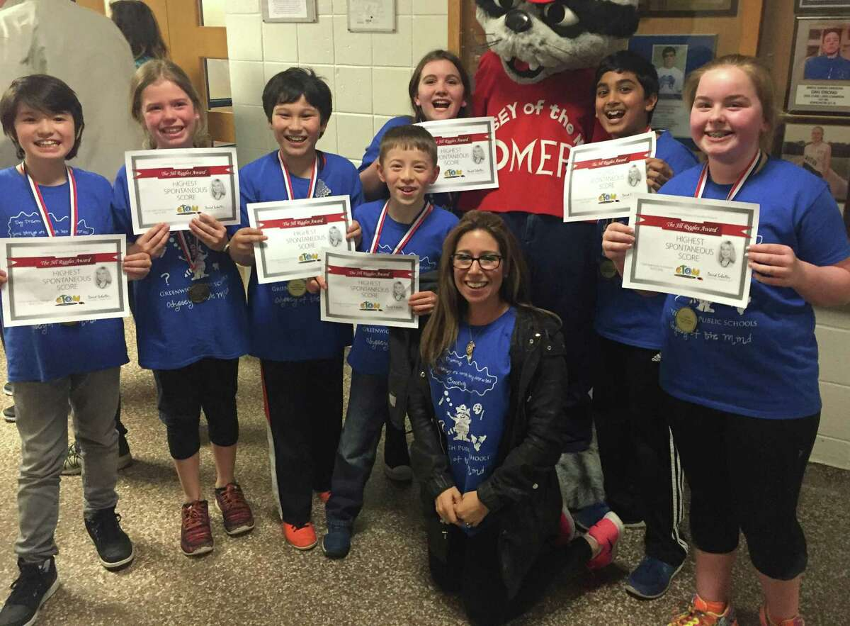 Cos Cob School's Classics Team qualified for the world fnals of the Odyssey of the Mind problem-solving competition with a first-place finish at the state finals. From left, are: The team includes Julian Wang, Angelica Marin, Nathan Apelgren, Kenneth Wilber, Juliette Homewood, Ronit Gupta, Deirdre Cunniffe. They are coached by Lori Leibowitz.