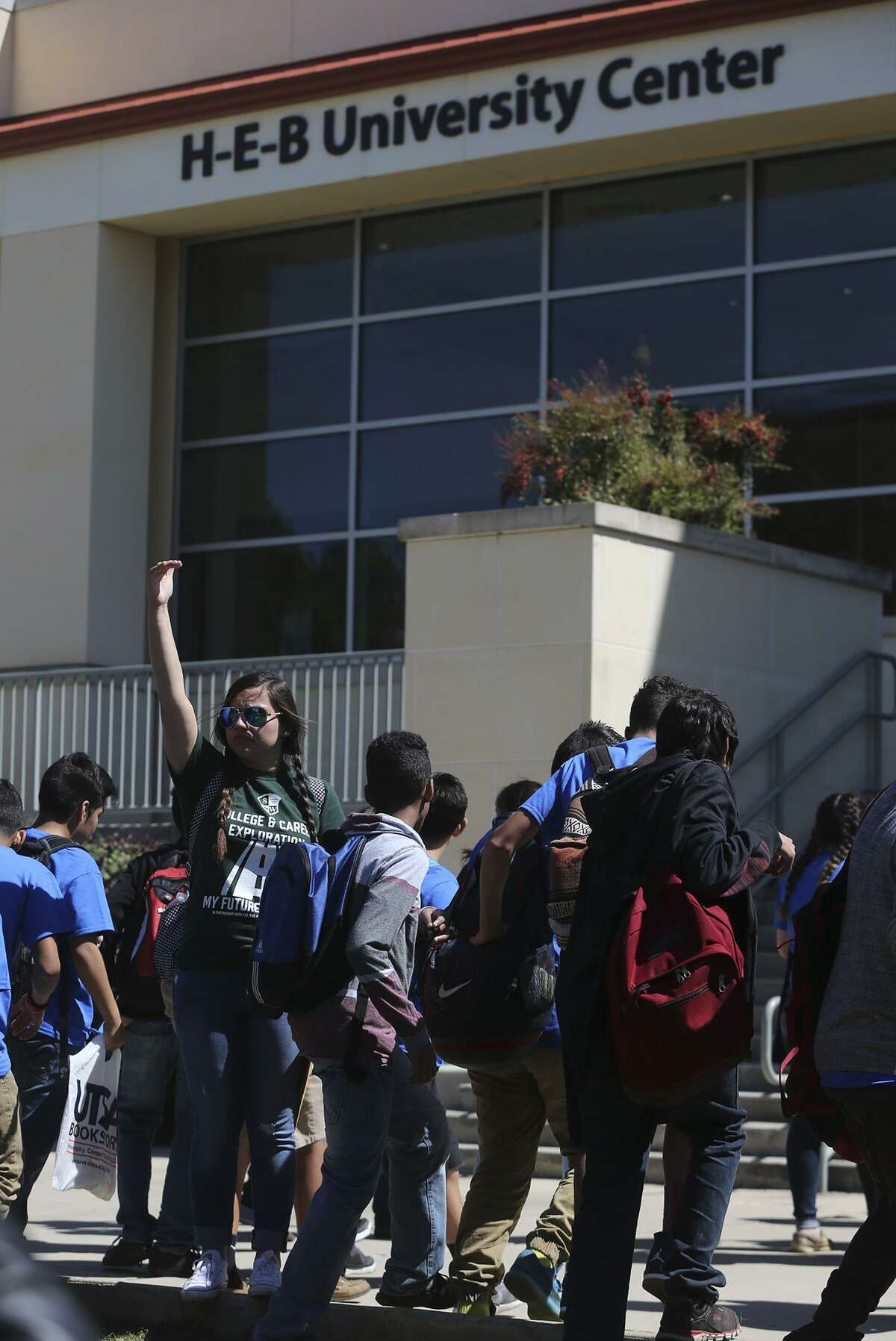 Eighth graderts from Southwest Independent School District middle schools enter the H-E-B University Center during the district's Career Exploration Day in 2016. Scobee Middle School teacher Rosalinda Boblett waves them in. All the district's eighth graders took ninth-grade Alegebra I instead of eighth grade math last year.