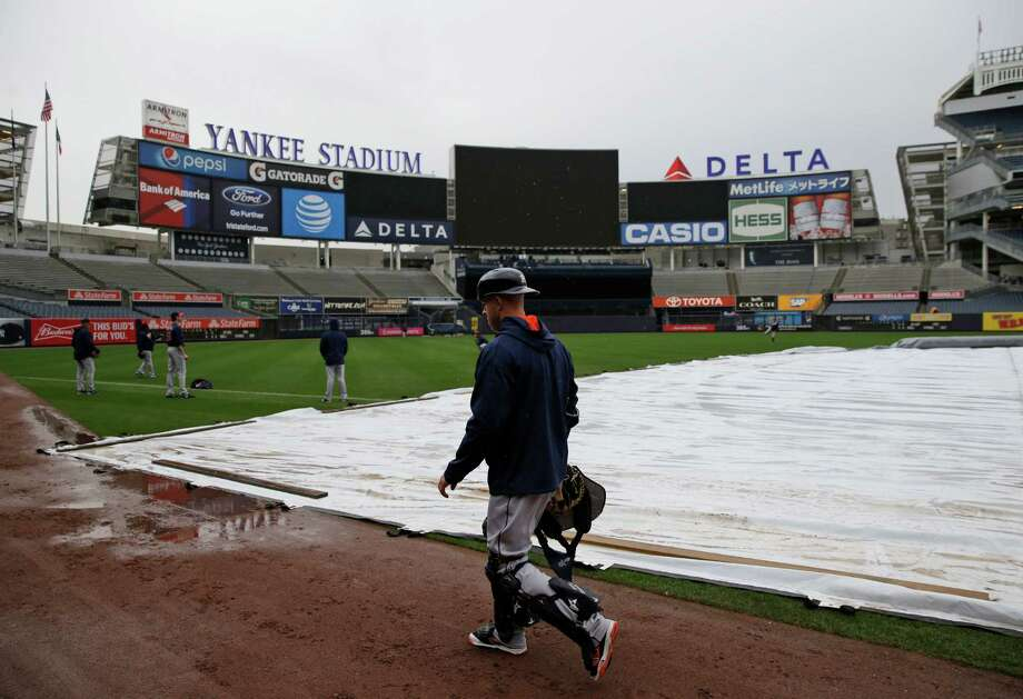 Most of the Astros worked out indoors at Yankee Stadium in the wake of Monday's postponement, but some couldn't resist getting a little work done on the field. Photo: Seth Wenig, STF