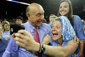 Dick Vitale, of ESPN, with University of North Carolina students before the start of the men's NCAA Division I national championship game between Villanova and North Carolina at NRG Stadium Monday, April 4, 2016, in Houston.