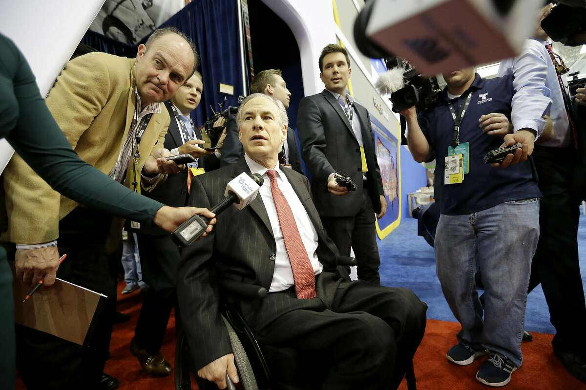"""File - In this Feb. 25, 2016, file photo, Texas Governor Greg Abbott arrives in the Spin Room before the Republican presidential primary debate at The University of Houston, in Houston. Abbott has written a book detailing how he overcame a freak accident that left him paralyzed from the waist down and outlining his plan to """"restore the Constitution."""" (AP Photo/David J. Phillip, File)"""