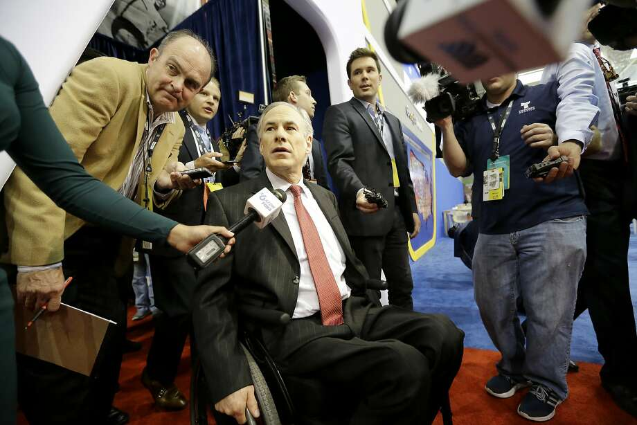 "File - In this Feb. 25, 2016, file photo, Texas Governor Greg Abbott arrives in the Spin Room before the Republican presidential primary debate at The University of Houston, in Houston. Abbott has written a book detailing how he overcame a freak accident that left him paralyzed from the waist down and outlining his plan to ""restore the Constitution."" (AP Photo/David J. Phillip, File) Photo: David J. Phillip, AP"