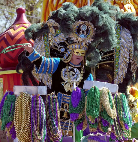 Mardi Gras parade krewes now will have to pay sales taxes on the plastic beads they throw to crowds as part of Louisiana lawmakers' plan to close a $3 billion budget deficit caused in part by the largest income-tax cut in state history. Photo: BILL HABER, STF / AP
