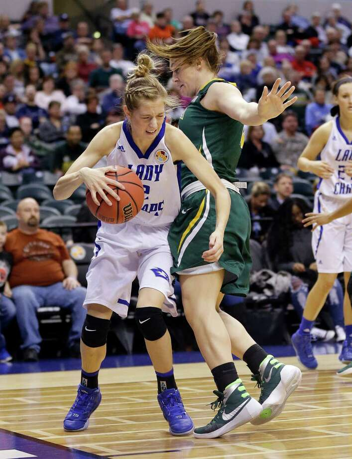 Lubbock Christian's Nicole Hampton is defended by Alaska Anchorage's Jenna Buchanan during the first half of the championship game at the women's NCAA Division II basketball tournament Monday, April 4, 2016, in Indianapolis. (AP Photo/Michael Conroy) ORG XMIT: NAF120 Photo: Michael Conroy / Copyright 2016 The Associated Press. All rights reserved. This m