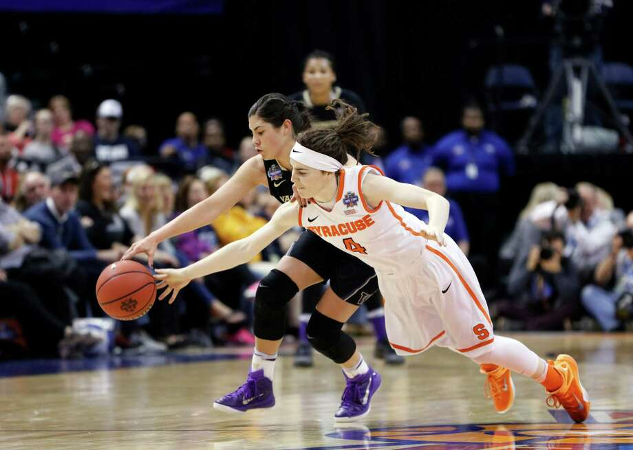 Washington's Kelsey Plum (10) and Syracuse's Maggie Morrison (4) battle for a loose ball during the first half of a national semifinal game at the women's Final Four in the NCAA college basketball tournament Sunday, April 3, 2016, in Indianapolis. (AP Photo/AJ Mast) ORG XMIT: NAF175 Photo: AJ Mast / FR123854 AP
