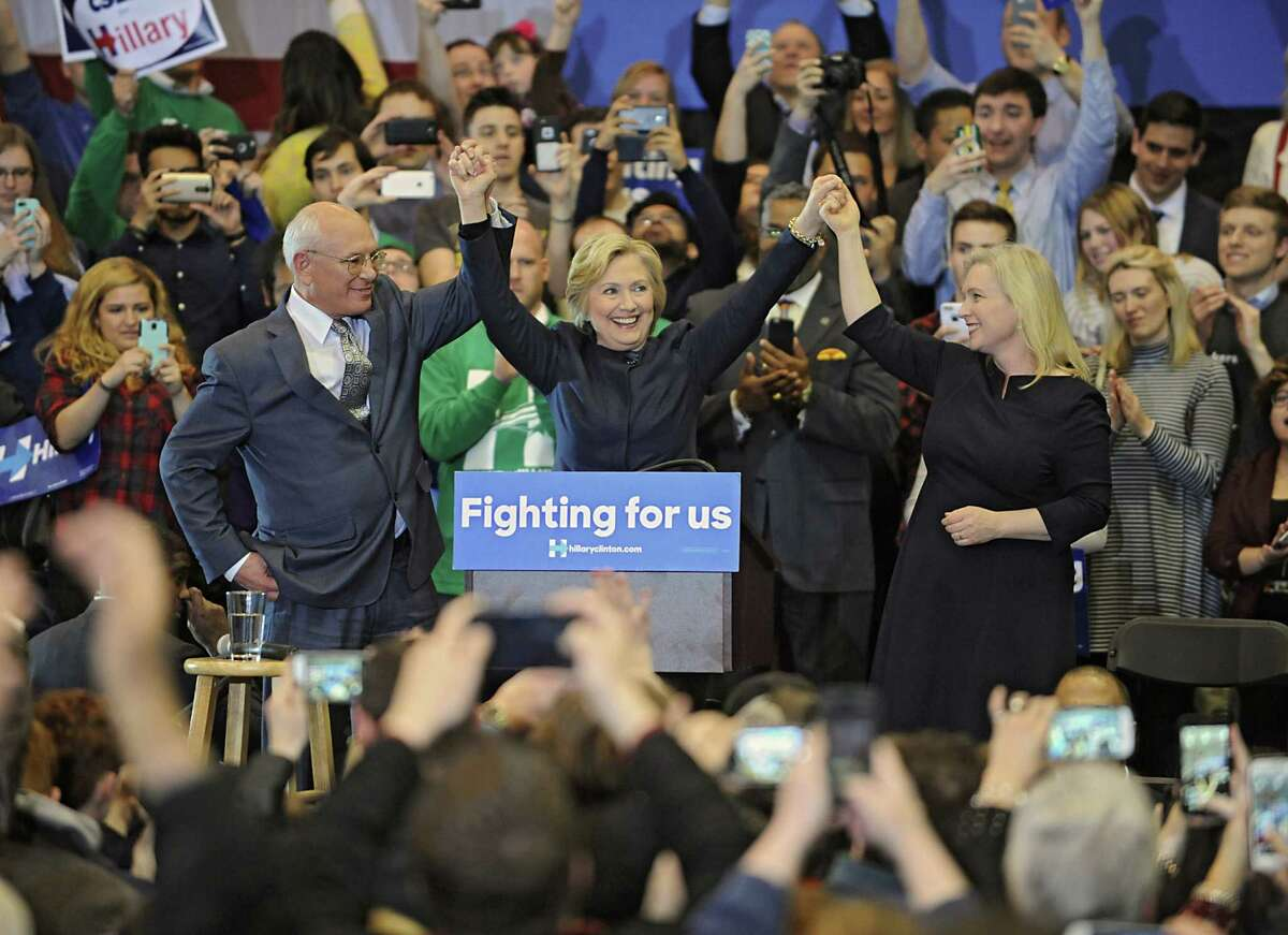 The crowd cheers as Congressman Paul Tonko, presidential candidate Hillary Clinton and United States Senator Kirsten Gillibrand hold up their hands at the end of a campaign rally at Cohoes High School on Monday, April 4, 2016 in Cohoes, N.Y. (Lori Van Buren / Times Union)