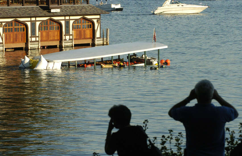People watch from the banks of Lake George as the tour ship Ethan Allen is raised from 70' below surface of the lake on Oct. 3, 2005, in Lake George N.Y. (Skip Dickstein/Times Union archive)