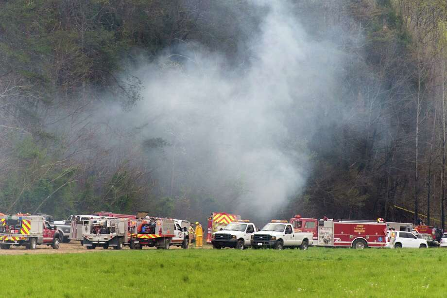 Emergency vehicles respond to the scene of a fatal helicopter crash, Monday, April 4, 2016, in Pigeon Forge, Tenn. A sightseeing helicopter crashed near the Great Smoky Mountains National Park in eastern Tennessee, officials said. (Saul Young/Knoxville News Sentinel via AP) Photo: Saul Young, MBI / Knoxville News Sentinel