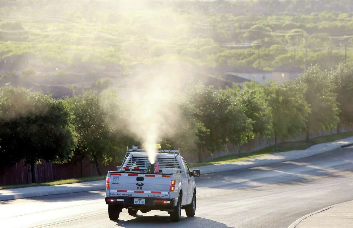 A Bexar County crew sprays for mosquitoes in the Canyon Crossing neighborhood on the far West Side.