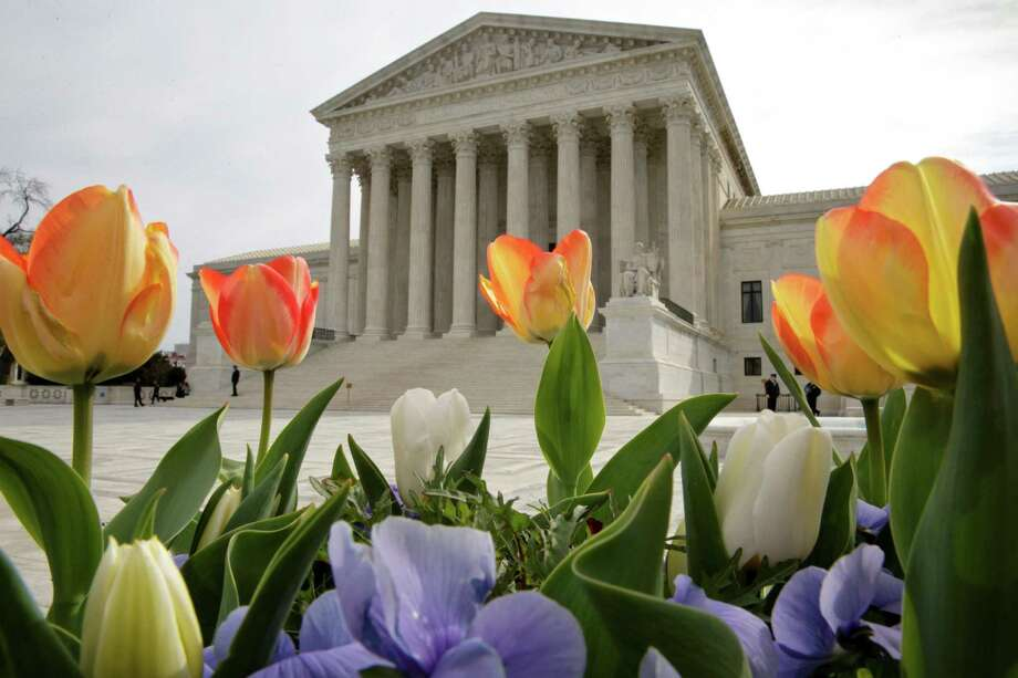 "The Supreme Court is seen in Washington, Monday, April 4, 2016, after justices ruled in a case involving the constitutional principle of ""one person, one vote"" and unanimously upheld a Texas law that counts everyone, not just eligible voters, in deciding how to draw legislative districts.  (AP Photo/J. Scott Applewhite) ORG XMIT: DCSA101 Photo: J. Scott Applewhite / AP"