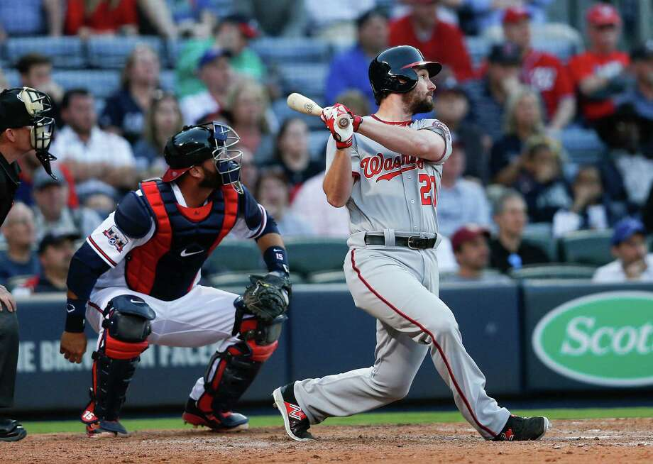 Washington Nationals' baseman Daniel Murphy (20) drives in a run with a double as Atlanta Braves catcher A.J. Pierzynski (15) looks on in the tenth inning of a baseball game Monday, April 4, 2016, in Atlanta. (AP Photo/John Bazemore) ORG XMIT: GAJB110 Photo: John Bazemore / Copyright 2016 The Associated Press. All rights reserved. This m