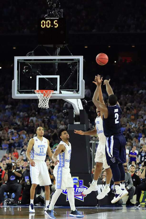 HOUSTON, TEXAS - APRIL 04:  Kris Jenkins #2 of the Villanova Wildcats shoots the game-winning three pointer to defeat the North Carolina Tar Heels 77-74 in the 2016 NCAA Men's Final Four National Championship game at NRG Stadium on April 4, 2016 in Houston, Texas.  (Photo by Ronald Martinez/Getty Images) ORG XMIT: 592274441 Photo: Ronald Martinez / 2016 Getty Images