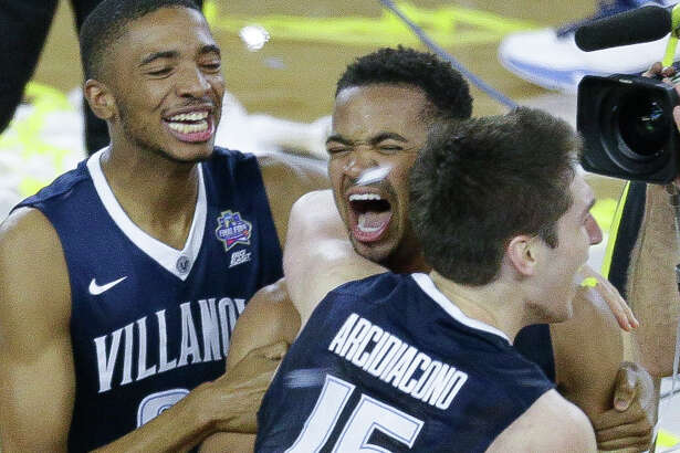 Villanova guard Phil Booth (5) Villanova guard Mikal Bridges (25) and guard Ryan Arcidiacono (15) celebrate during the NCAA National Championship at NRG Stadium Monday, April 4, 2016, in Houston.
