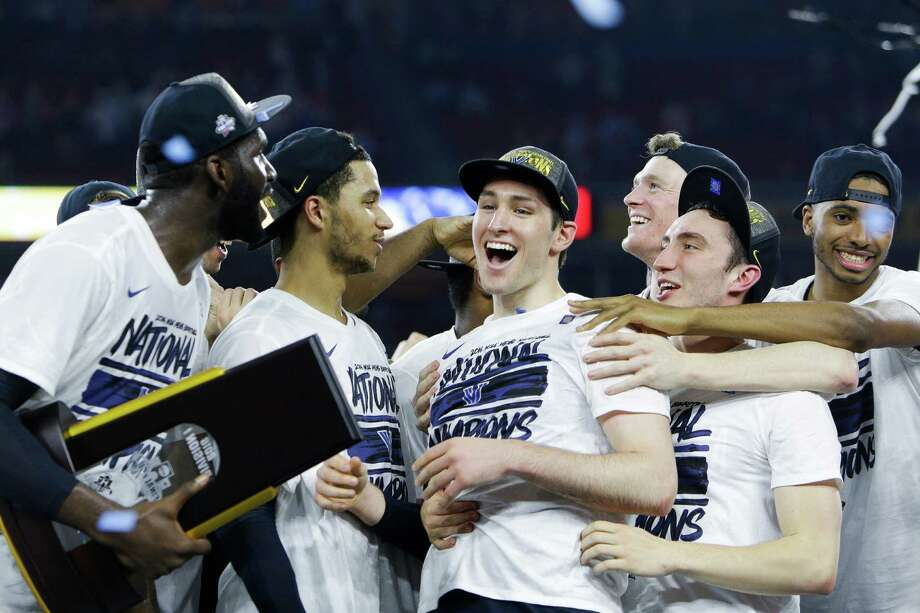 Villanova guard Ryan Arcidiacono (15), center, celebrates with his team after winning the NCAA National Championship at NRG Stadium, Monday, April 4, 2016, in Houston. Photo: Brett Coomer, Houston Chronicle / © 2016 Houston Chronicle