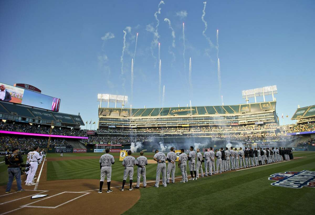 Fireworks erupt as players line up on the baselines before the A's played the Chicago White Sox at the Oakland Coliseum in Oakland, Calif., on Monday, April 4, 2016.