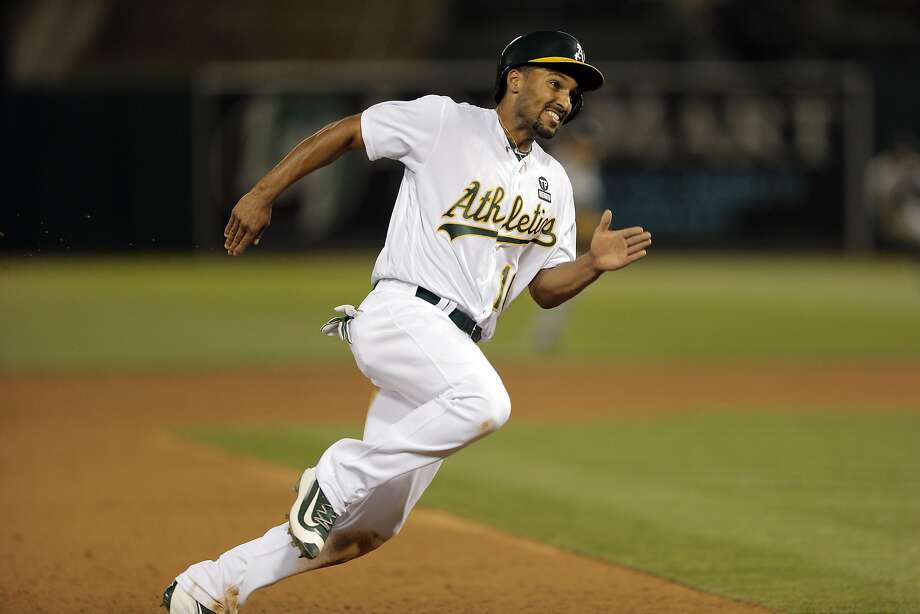 Marcus Semien (10) rounds third on his way to score in the third inning as the A's played the Chicago White Sox at the Oakland Coliseum in Oakland, Calif., on Monday, April 4, 2016. Photo: Carlos Avila Gonzalez, The Chronicle