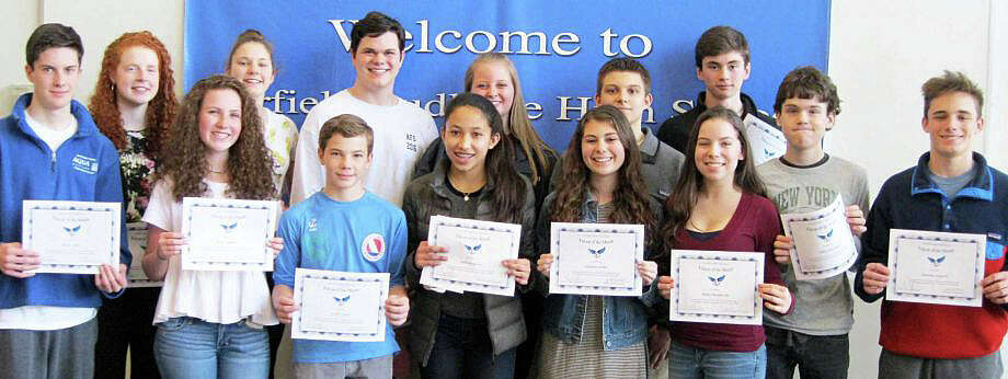 """Fairfield Ludlowe High School students selected as the latest """"Falcons of the Month"""" include, front row from left, Brian Duffy, Kalle Meehan, Everett Nash, Gabriela Furey, Kathleen Hinkle and Emma Manderville; back row, Aoife Cahill, Margaret Burns, John Mazza, Mia Tommins, Stanislaw Godlewski, Kieran Barker, Ethan Durham and Jonathan Hogarth. Missing from photo is Jesse Lanham. Photo: Contributed Photo / Fairfield Citizen"""