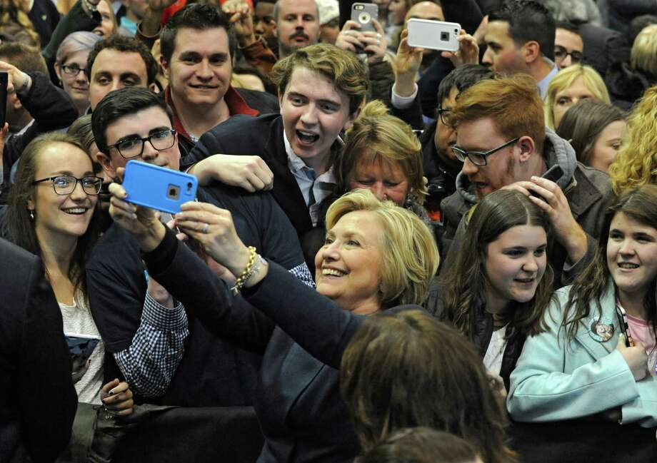 Presidential candidate Hillary Clinton greets people and has selfies taken with supporters after holding a campaign rally at Cohoes High School on Monday, April 4, 2016 in Cohoes, N.Y. (Lori Van Buren / Times Union) Photo: Lori Van Buren / 10036059A