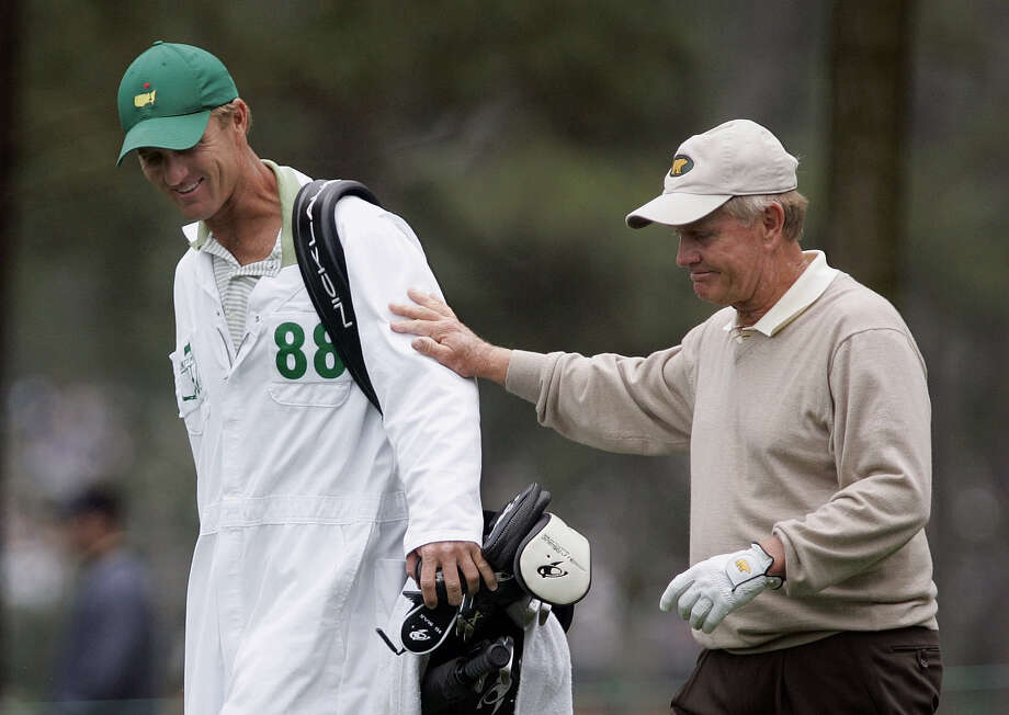 FILE - In this April 9, 2005, file photo, Jack Nicklaus, right, walks with his son and caddie, Jack Nicklaus II, on the ninth hole during second round play of the Masters golf tournament at the Augusta National Golf Club in Augusta, Ga. Nicklaus' oldest son caddied for him at the 1986 Masters, when the older Nicklaus _ then 46 _ made one of the most unlikely  comebacks in major history. (AP Photo/Amy Sancetta, File) ORG XMIT: NY159 Photo: AMY SANCETTA / AP