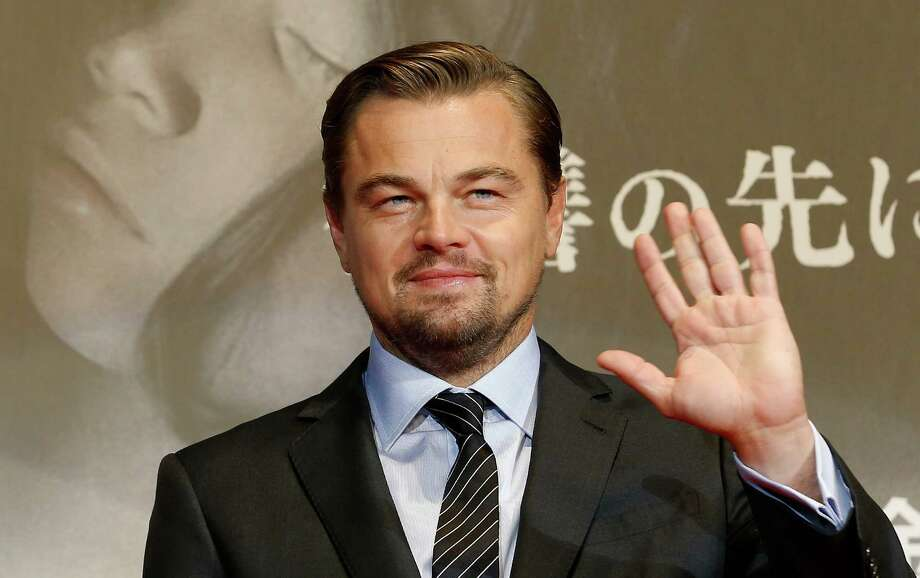 "FILE - In this March 23, 2016 file photo, American actor Leonardo DiCaprio waves for fans during the Japan premiere of his new movie ""The Revenant"" in Tokyo, Japan. Indonesia's environment and forestry minister says Oscar-winning actor DiCaprio lacked complete information when he criticized the destruction of rainforests during a visit to a protected national park in March. His comments prompted immigration officials to warn that DiCaprio could be barred from reentering Indonesia, but the minister, Siti Nurbaya, said she appreciates his good intentions and hopes to cooperate with him in future. (AP Photo/Shizuo Kambayashi, File) ORG XMIT: TOK101 Photo: Shizuo Kambayashi / AP"