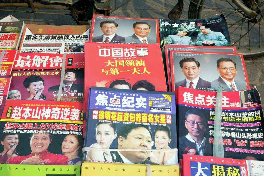 Chinese magazines featuring former Chinese President Hu Jintao and former Chinese Premier Wen Jiabao are displayed at a newsstand in Beijing, China, Tuesday, April 5, 2016.  Previous reports by international media on the personal finances of Chinese leaders have drawn retaliation from Beijing, frequently through the blocking of media websites and a refusal to issue visas to their journalists. (AP Photo/Ng Han Guan) ORG XMIT: XHG105 Photo: Ng Han Guan / AP